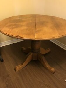 Solid wooden table with leaf