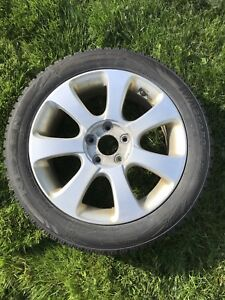 Low profile snow tires on alloy rims. (4)