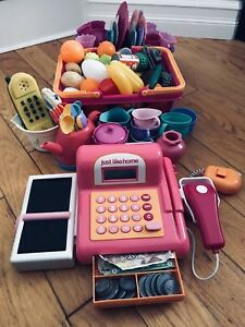 Cash register with play food and dishes