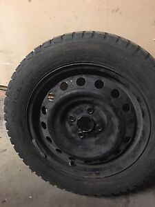 Two tires with rims