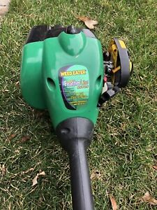 Weed eater gas grass trimmer.