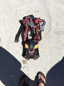 Fall arrest harness with lanyard