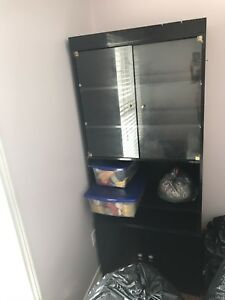 Tall black cabinet Italian furniture piece with glass door
