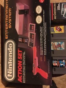 Nintendo in box with original boxed controllers