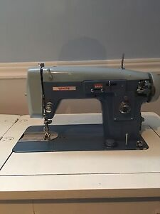 White sewing machine fold away table