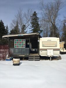 Trailer on seasonal lot with golf cart Whispering Winds.