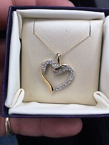 Heart shaped 10k gold and diamond pendant + 10k gold chain