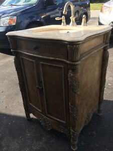 """Gilded 24"""" Vanity and Stone Counter top."""