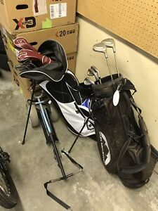 Golf clubs, bags, roller caddy.