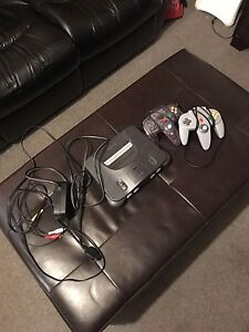 N64 with 2 controllers and super Mario 64