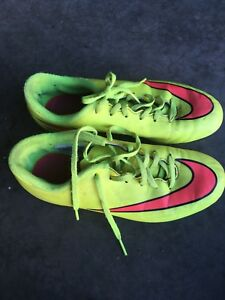 Size 4 Nike football cleats