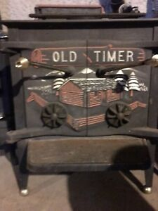 Beautiful OLD TIMER  Wood stove and fireplace