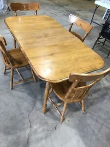Dining room table with 4 chairs. Maple. $100