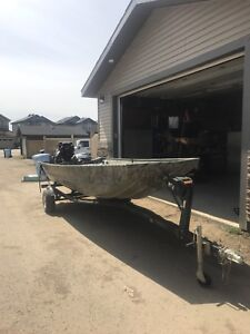 Lund Jon boat and 27hp mud buddy