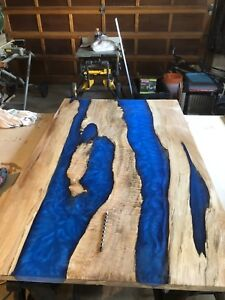 Custom epoxy river table
