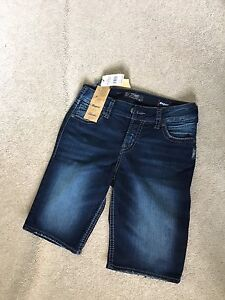 Brand new with tags Silver Bermuda shorts. Size 30