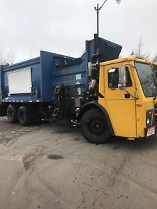 2012 Mack with McNeilus auto reach side loading garbage truck