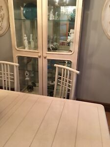 Formal dining room with chairs and curio cabinet