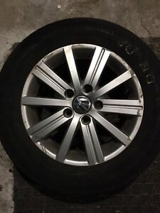 Four Volkswagen Rims and Continental tires 195/65R15