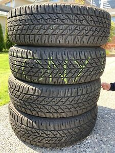 One set of 4 235/65/17 inch winter / all season tires
