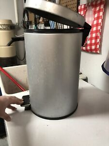 Small silver pop-up garbage can.
