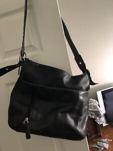 Rolf's black leather purse in good condition