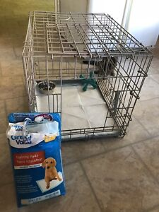 Kennel, training pads and bowl