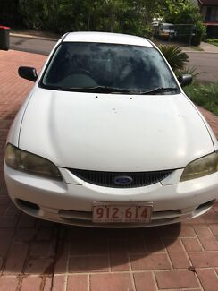 1998 white manual Ford Laser Sedan