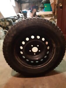 4 studded winter tires on rims for a Mitsubishi Outlander