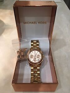 Women's rosegold Michael Kors watch +links and new battery