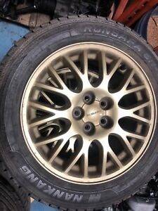 Des beaux mags de Subaru Wrx 5X100 ( 205/55/16) Pneusd'hiver