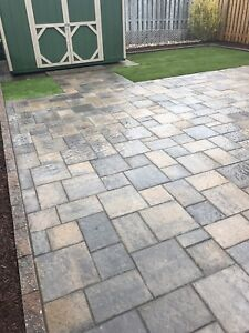 A Couple Landscapers: Patio Stones, Interlock, Sod.