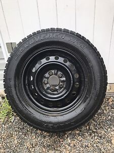 ***Like new winter studded tires with rims ***215/70R16