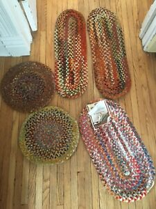 Antique small braided rugs.