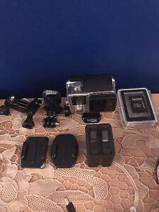 GoPro Hero 4 with all accesories(used only once)
