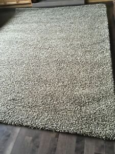 Brand New Brown & Grey Large Shag Rugs $225 each.