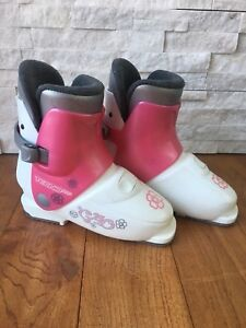 Skis and boots for girl