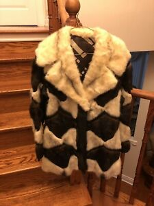Real fur and black leather coat