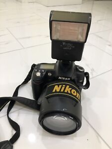 Nikon D90 DSLR camera with 18-105 lens and external flash