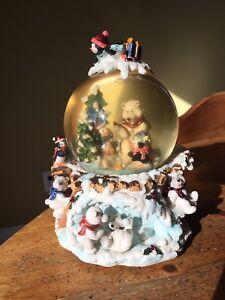 Musical snow globe- fishing polar bear and penguins