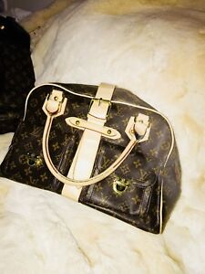 4 purses to sell 3 Louis Vuitton and 1 Hugo Boss negotiable
