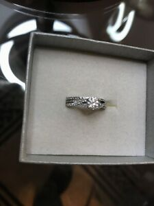 Engagement Ring, wedding band and necklace