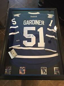 Signed Jake Gardiner Toronto Maple Leaf jersey (( Framed))
