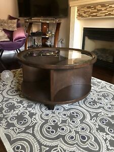 Round wood and glass coffee table