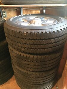 Stock rims and tires (8 Tires)