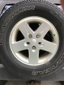 Set of 4, 2012 Jeep Wrangler rims and tires