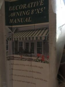 PATIO OR DECK COVER; RETRACTABLE MANUAL AWNING 8'X 5'; BRAND NEW