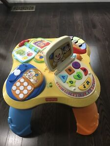 Fisher-Price Laugh & Learn Fun with Friends activity table.