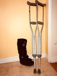 Child's walking boot and crutches
