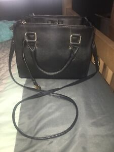 Ladies black purse bought at Spring perfect shape lots of room
